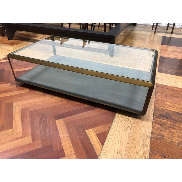 Design Plus Gallery presents a New Bentley shadow box coffee table by Four Hands. The angled metal frame has an antique...