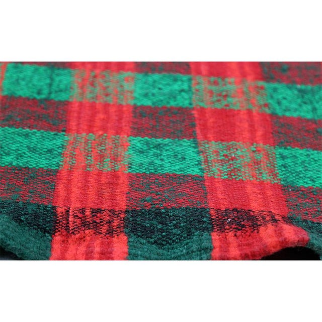 This beautifully simple rug is a traditional flatweave Kilim tribal rug featuring a vibrant multi-colored plaid design....
