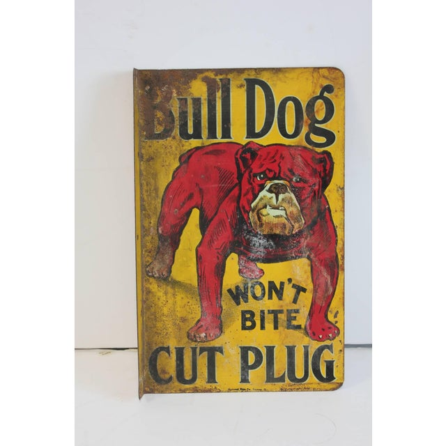 "1900s ""Bull Dog Won't Bite Cut Plug"" chew tobacco double-sided tin sign with flange mount. This piece would look great in..."