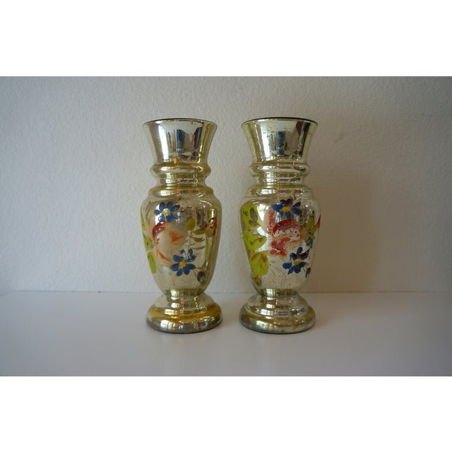Super cute pair of 1920s mercury glass vases, could also be used as candle holders. Hand-painted floral design on each....