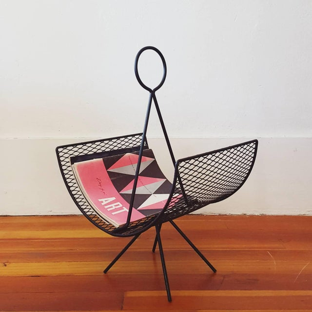 """Iron and expanded metal """"Anchor"""" magazine rack, designed by Seymour Robins for Sondra Kay Interiors in the early 1950s...."""