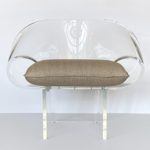 Stunning sculptural Lucite ribbon lounge chair by Robert Van Horn, circa the 1970s. This signed all original example is...