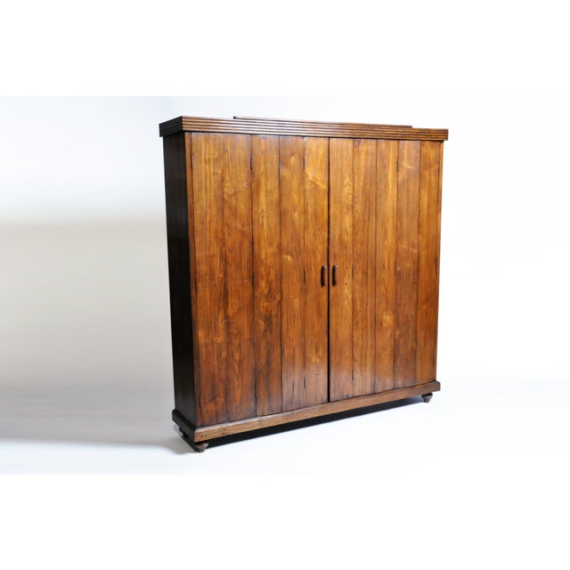 This handsome Art Deco cabinet is from Burma and was made from teak wood, circa 1940. This piece features three shelves...