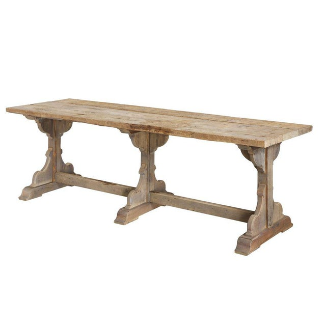 A rectory style wooden table that is hand made from reclaimed wood that creates an old/worn look. This table has classic...