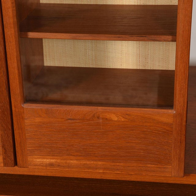 This Danish Modern 2-door hanging display cabinet will store your precious items in luxury. Fabricated of teak, the rich...