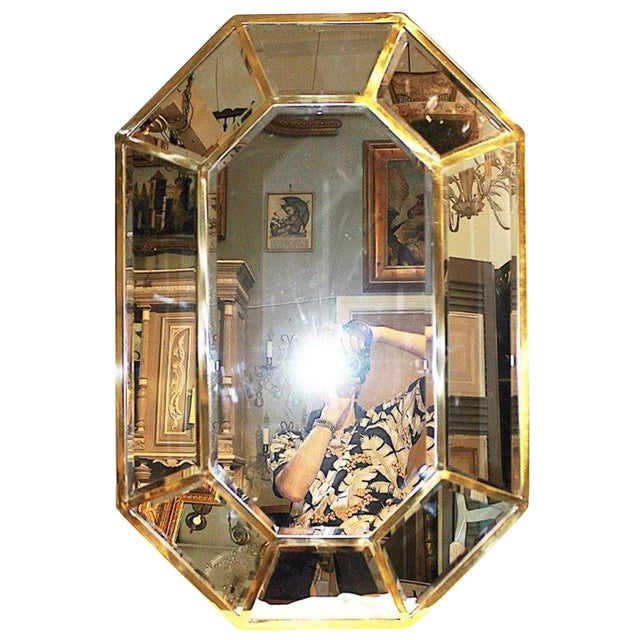 What an unusual piece-a mirror on mirror fully beveled panel wall mirror in solid brass, hand it either way with a wire...