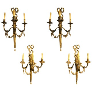 Set of Four Large Ornate Three-Light Torch and Ribbon Form Wall Sconces For Sale