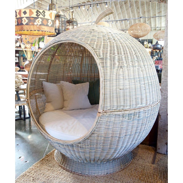 Giant apple shaped pod bed made from durable outdoor synthetic weaved rattan material. A unique fun piece for a large...