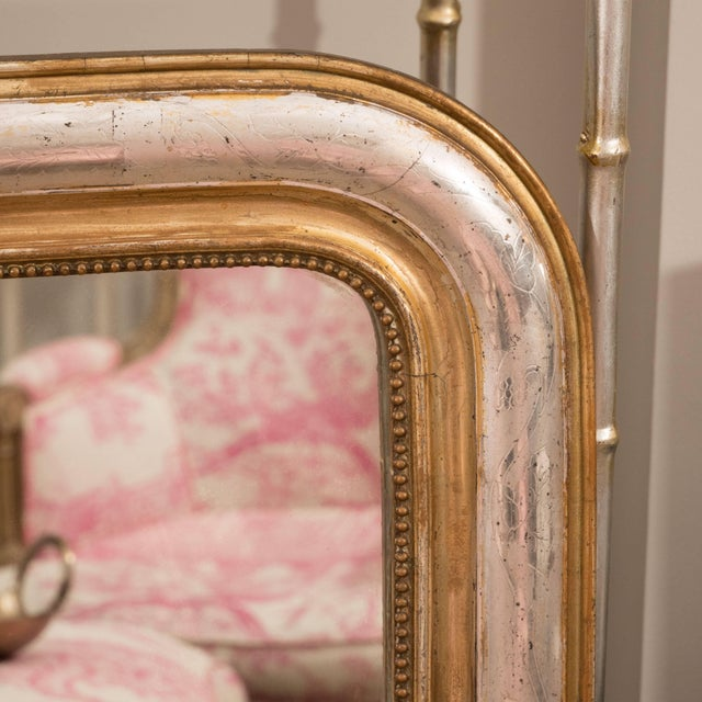 This Classic Louis Philippe mirror is unique in that it is finished in both silver leaf gold leaf. It features an inner...