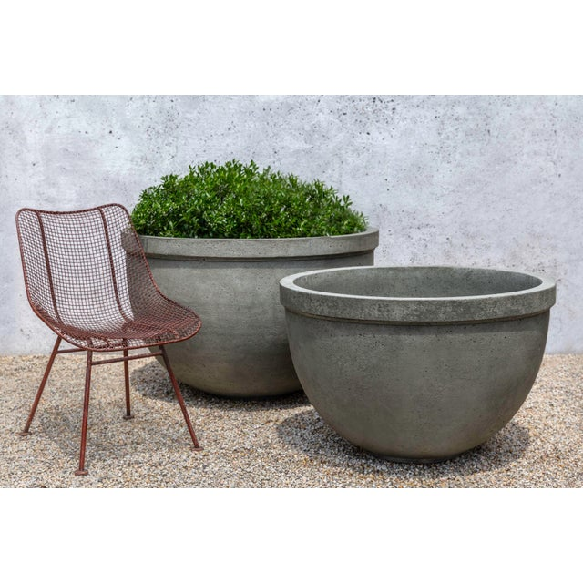 A simple, rounded planter in an Alpine Stone finish. Available in large and small versions.