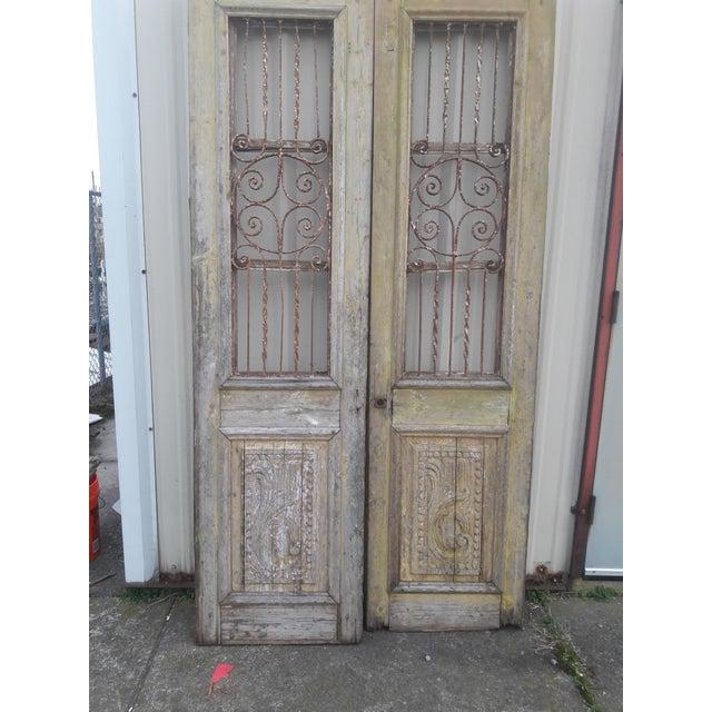 Wonderful pair of old French/Mediterranean door, layers of patina on origianl wood finish. Decorative wrought iron window...