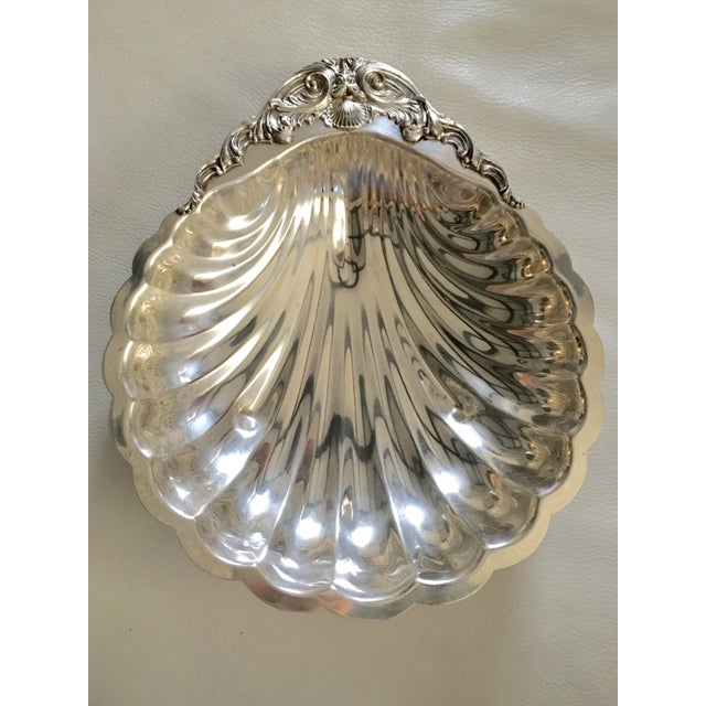 Exquisite shell shaped silverplate FB Rogers large serving or decorative bowl with scallop and ornate details.