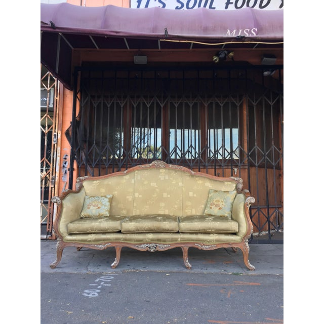 Antique French carved frame sofa with a beautiful light olive green silk upholstery, with a side of two small cushions,...