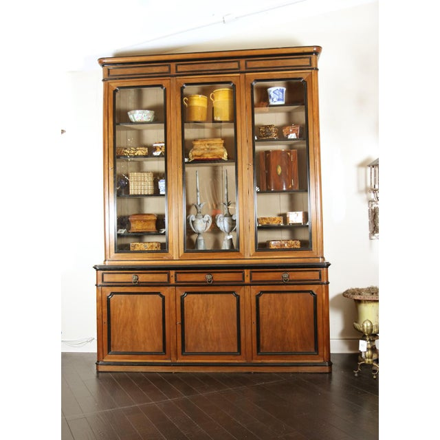 An impressive French Walnut Bureau Bookcase with ebonized trim and original glazing. French circa 1860, height: 116 in....