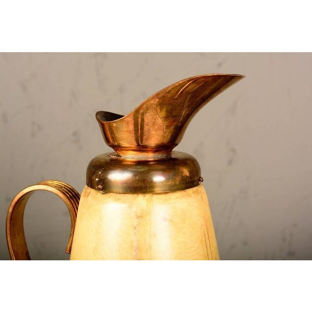 For your consideration a beautiful Aldo Tura beige goatskin and brass pitcher. Made in Italy, circa 1960s.