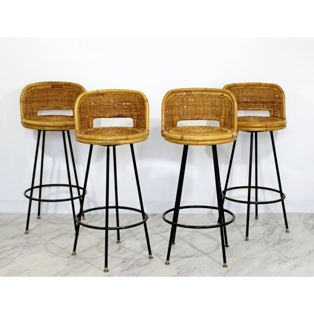 For your consideration is a gorgeous, set of four, bamboo rattan, swivel barstools, by Danny Ho Fong, circa the 1960s. In...