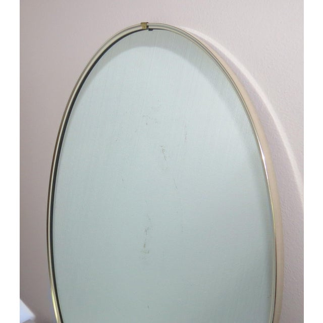 """Beautiful mid-century modern oval chrome mirror by Turner Manufacturing (Chicago, IL). """"A True Quality Fashion Plate..."""
