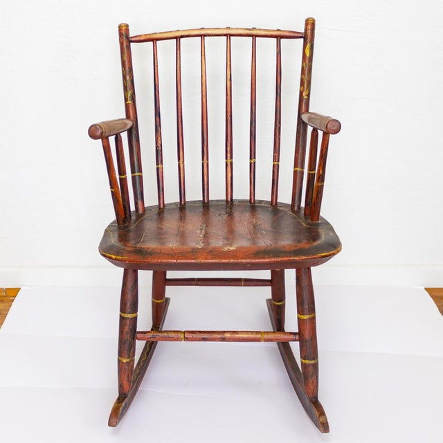 Grain painted child's rocking chair features Pre - Civil War, handcrafted construction dating around 1840 - 1850 from...