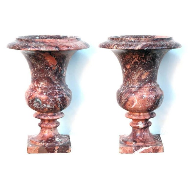 An elegant pair of French campagna urns of opera-fantastico marble; each well-figured urn of campagna form with everted...
