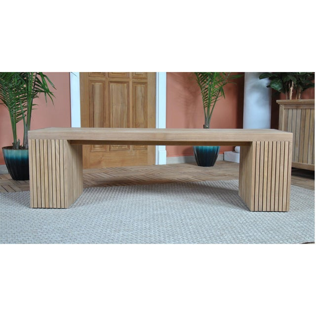 A solid teak bench the Niagara Teak Liner Bench Stool measures 59 inches in length and is suitable for use either indoors...