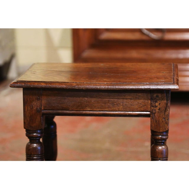 This elegant antique stool was created in Northern France, circa 1880. Built of chestnut and rectangular in shape, the...