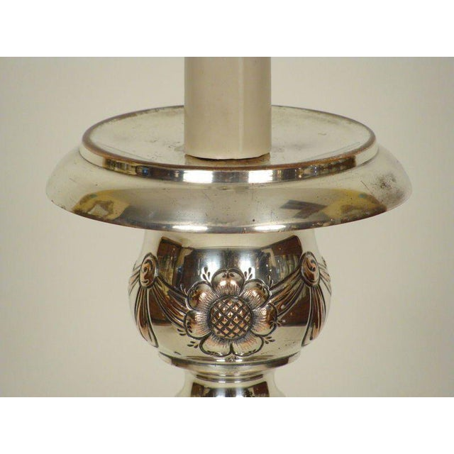 Louis XlV style silver on copper altar stick lamp, 19th century.The height to the top of the finial is 47 and the height...