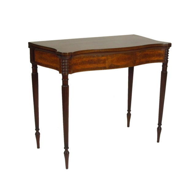 An exceptional pair of late 19th-C. Federal style inlaid mahogany fold-top card tables with figured maple and rosewood...