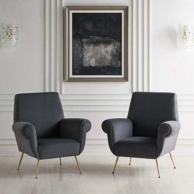 A pair of comfortable and luxurious Italian lounge chairs attributed to Gigi Radice. sourced in Europe. These Italian...