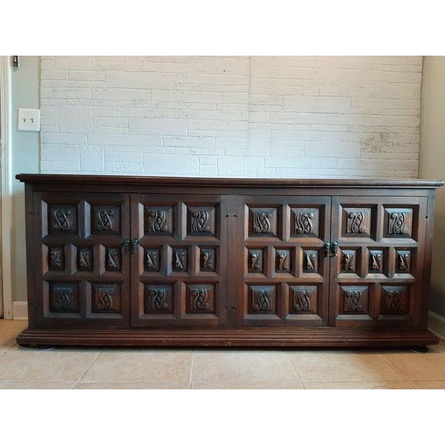 Vintage hand-carved sideboard from Artes De Mexico. Heavy, dark Pine, 4 door construction. All original. Has one shelf...