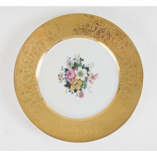 Spectacular set of 12 22 karats Gold Encrusted Floral Dinner Plates from an esteemed German company, Hutchenreuther....