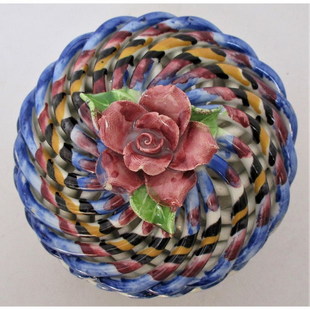 Small Capodimonte hand-painted porcelain lidded container in a traditional woven design with a rose accent on the lid. No...