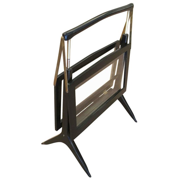 Foldable Italian Mid-Century magazine rack. Made in wood with glass paneling and brass details.
