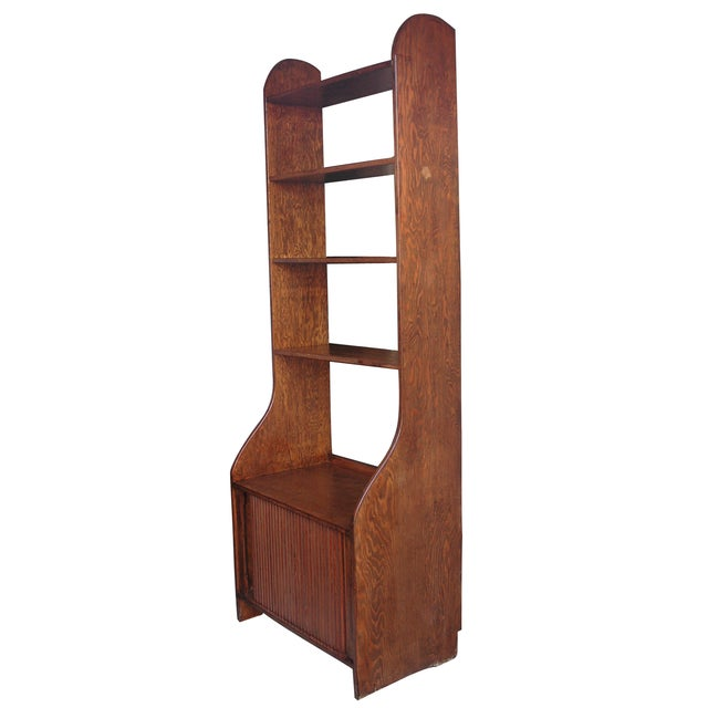 Mid-century modern handmade walnut wood bookcase with tambour doors. Three shelves are adjustable with additional storage...