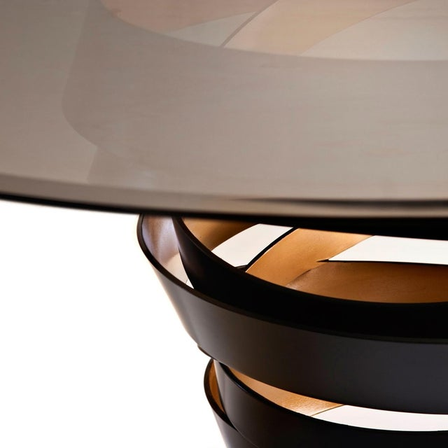 The swirling metal ribbon of the Intuition Dining Table evokes the mysterious and divine feminine instinct. Carefree and...