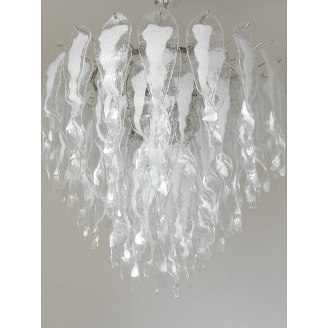 Italian chandelier shown with milky white and clear Murano glasses hand blown to form beautiful dangling stalactite shaped...