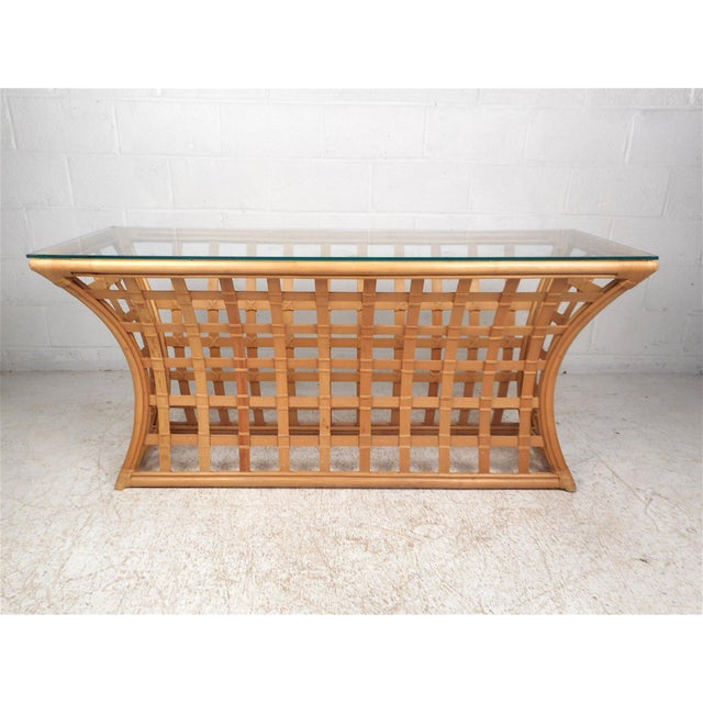 Unique vintage modern bamboo and glass console table. Base features an interesting hourglass contour, giving the piece a...