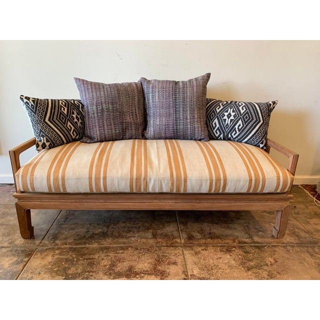 Charming American day bed with comfortable linen cushion in wheat with gold stripes. Beautiful natural walnut finish....