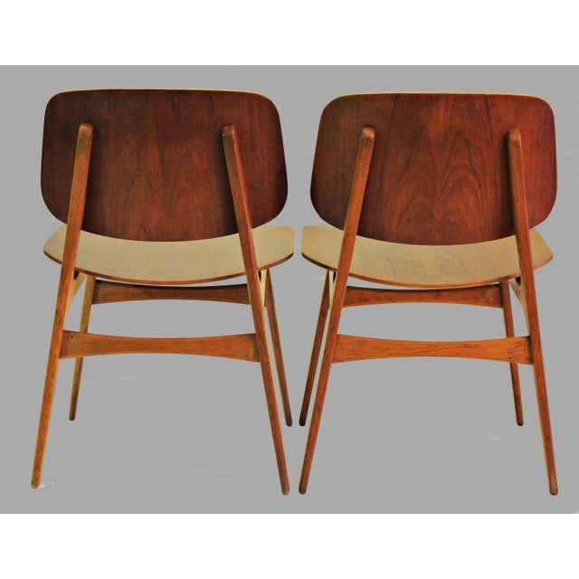 Set of two shell chairs designed in 1950 for Søborg Møbelfabrik. The shell chair distinguishes itself by the use of a...