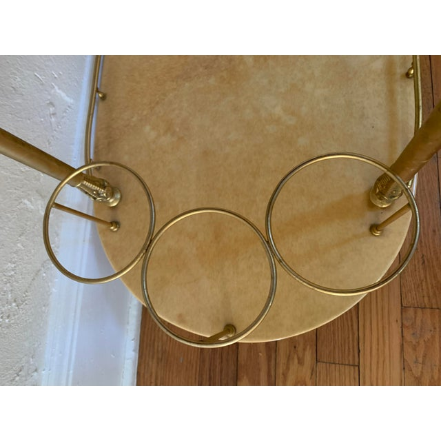 A lovely bar cart from an antique store in Atlanta. Glorious brass hardware. Classic Aldo Tura piece. Marked on reverse of...