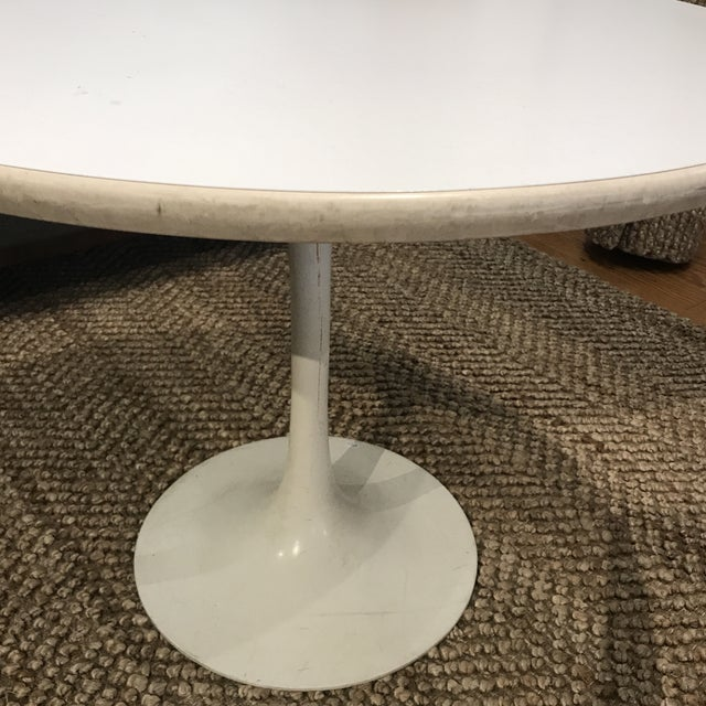 Vintage mid-century Saarinen style tulip table in good condition, showing wear from age (marks, scuffs, scratches). Table...