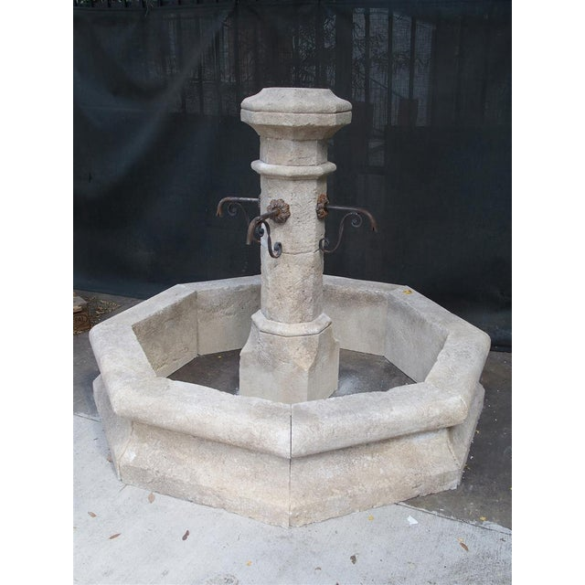 This hand-carved limestone, center fountain from France is octagonal and has well shaped basin stones instead of flat. It...