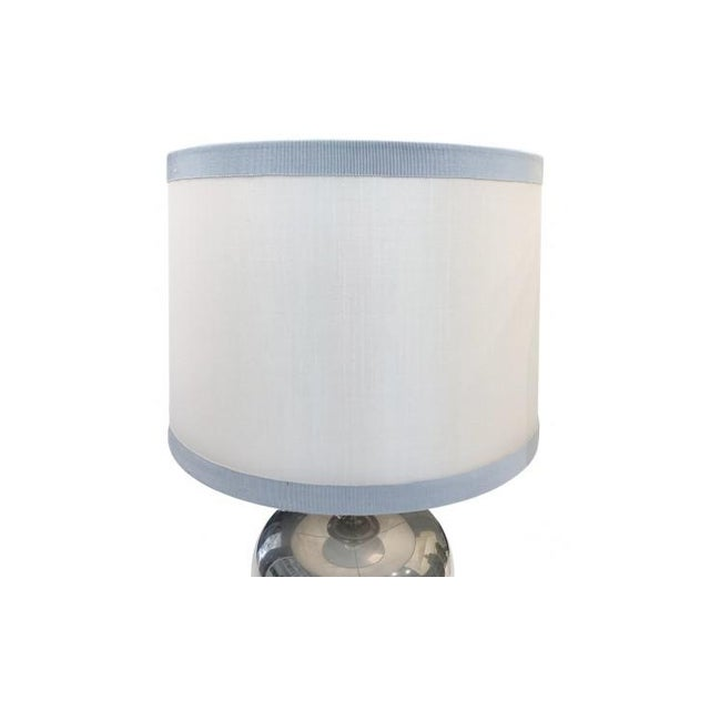 French lighting company Maison Barbier . Polished steel table lamp. Custom off-white stretched silk drum shade with light...