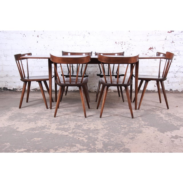 A rare and exceptional mid-century modern seven-piece dining set including drop-leaf harvest table and spindle back dining...