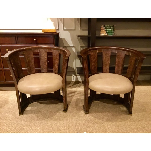 Unique pair of Pair of Caracole Burl-Esque Barrel Chairs, finished in a medium burl wood with a warm creamy taupe seat and...