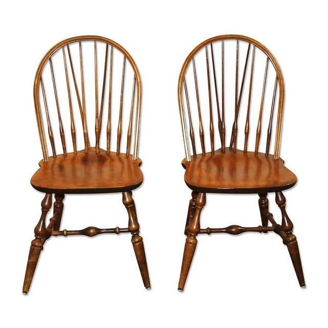Bow back Windsor wooden chair. Price is per chair. Listing is for a single unit but 10 are available. Please contact...