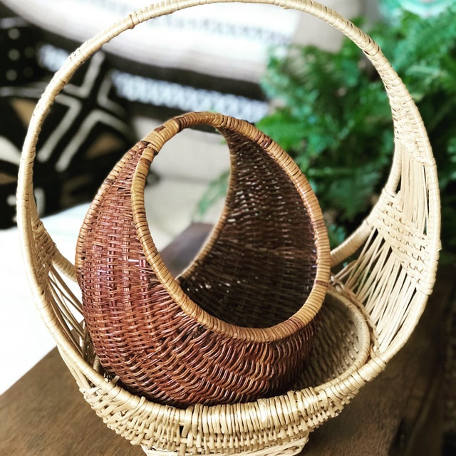 Set of vintage two half moon nesting baskets. A fun boho accent for any space!