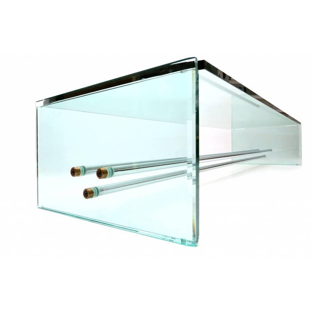Rare glass coffee table tubular chrome brass Fontana Arte, Italy 1970s Measures: L 184 cm x D 55 cm x H 33 cm.