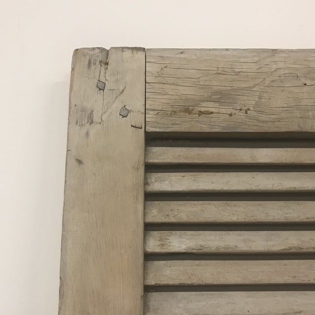 Nice pair of 19th century weathered gray oak shutters with mortise and pegged construction. Can be used hinged together or...