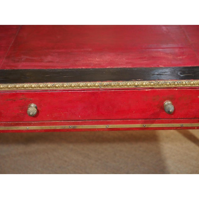 This is a great desk painted in red with red leather in the center, black painted around the edges and brass gallery...