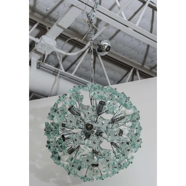 We're enchanted by this dandelion-style 60's Italian sputnik chandelier. The 13-light, chrome frame holds gorgeous green...